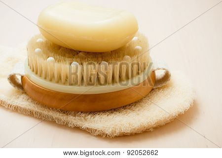 Closeup Body Brush Soap And Scrub Glove