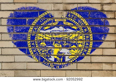 Heart Shape Flag Of Nebraska On Brick Wall