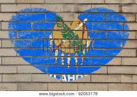 Heart Shape Flag Of Oklahoma On Brick Wall