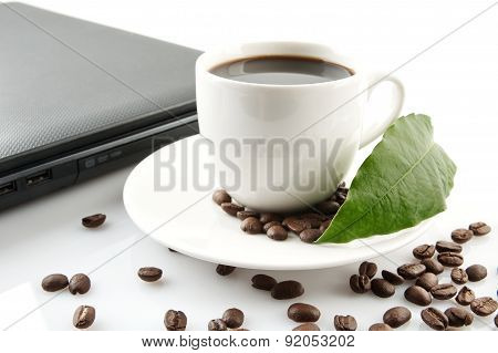 Cup Of Coffee With Laptop At Breakfast