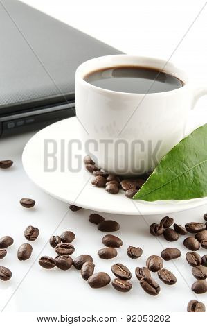 Cropped Cup Of Coffee With Laptop At Breakfast