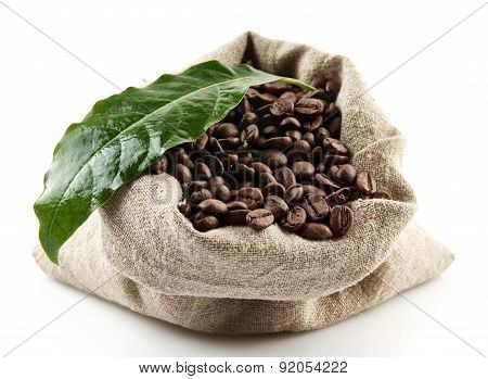 Sack Full Of Coffee Beans On White With Green Leaf