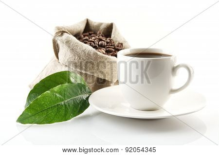 Sack Full Of Coffee Beans With Green Leaf And Coffee Cup