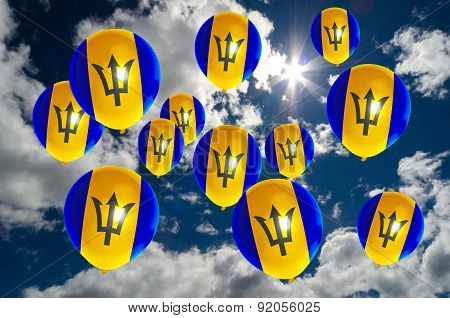 Many Balloons With Barbados Flag On Sky