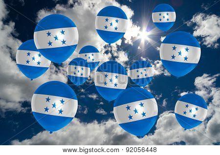 Many Balloons With Honduras Flag On Sky