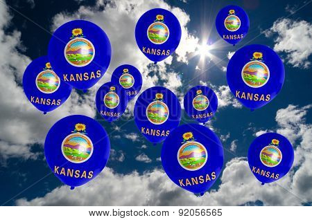 Many Balloons With Kansas Flag On Sky