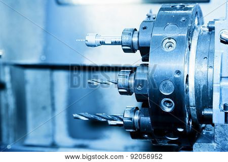 Industrial CNC drilling and boring machine in workshop. Industry concept, blue tone.