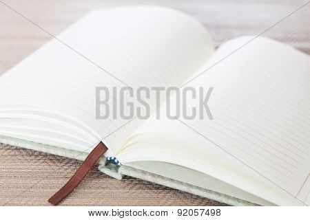Open Blank Notebook On Table