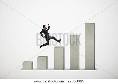 businessman running up the concrete diagram over light grey background