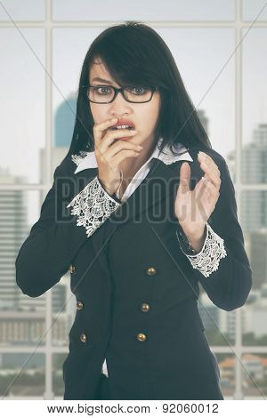Afraid Businesswoman Standing In Office