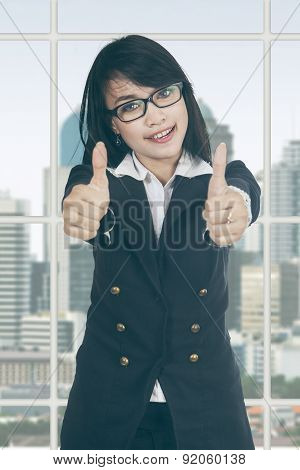 Attractive Female Entrepreneur Shows Thumbs Up