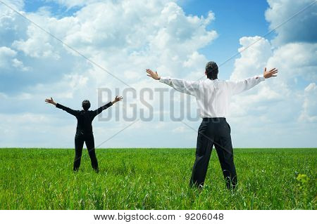 Businesspeople Standing On Green Grass