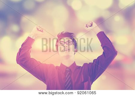 Excited Businessman With Festive Light Background