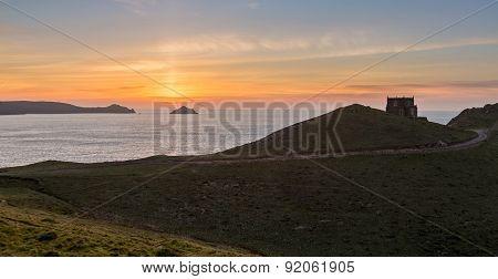 Sunset Over Doyden Castle On Coastline At Port Quin