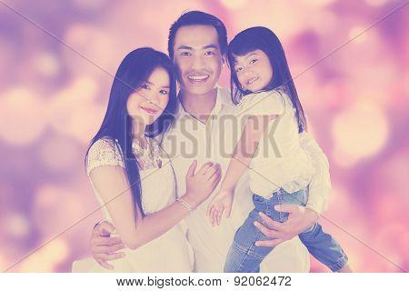 Joyful Family With Festive Light Background