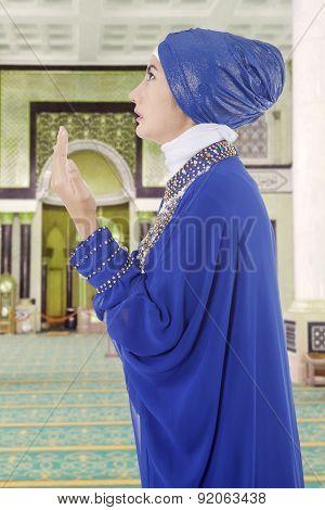 Muslim Woman Praying In Mosque 1