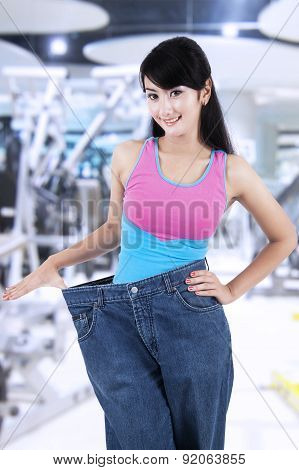 Pretty Woman With Old Jeans At Gym Center