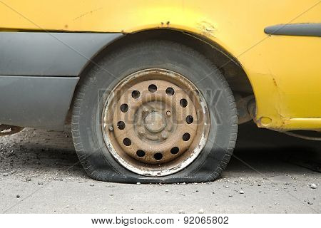 Flat tire of an old car