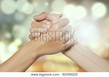 Two Hands Holding To Each Other