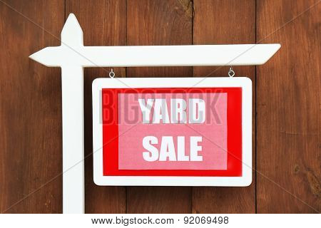 Wooden Yard Sale sign on wooden fence background