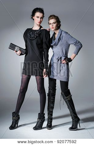 young attractive two girl wearing black and grey cloth posing