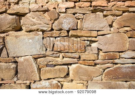 Rustic Wall With Layers Of Different Shapes Of Rough Sandstones