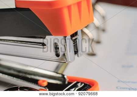 Stapler On White Paper Business