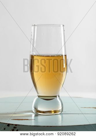 Glass of water on table on light background