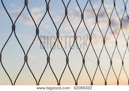 Metal Mesh Wire Fence Closeup Sunset Sky Background