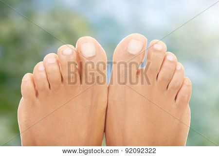 Pure and smooth female bare feet.