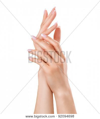 Beautiful Female Hands. Spa and Manicure concept. Woman hands with french manicure. Soft skin, skincare concept. Beauty nails. Isolated on white background