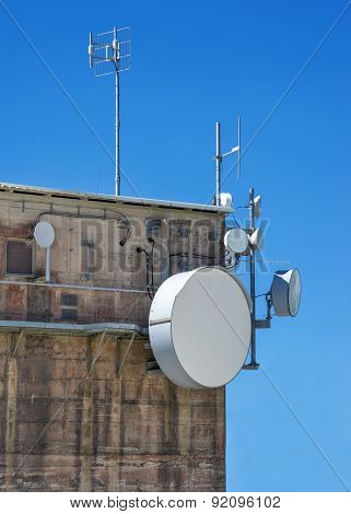 Modern antennas on an old industrial building