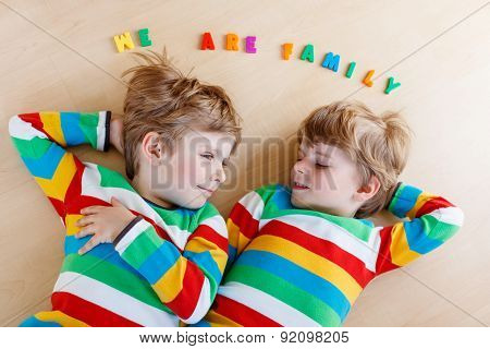 Two Little Sibling Kid Boys Having Fun Together, Indoors