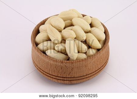 Peanuts In A Round Wooden Form
