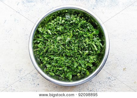 finely chopped fenugreek leaves kept in a bowl on a blurred background