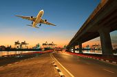 Постер, плакат: Road land Bridge Run Into Ship Port And Commercial Cargo Plane Flying Above Use For Land air And V