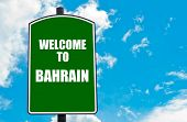 picture of bahrain  - Green road sign with greeting message WELCOME TO BAHRAIN isolated over clear blue sky background with available copy space - JPG