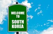 image of south-pole  - Green road sign with greeting message WELCOME TO SOUTH KOREA isolated over clear blue sky background with available copy space - JPG