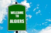 stock photo of algiers  - Green road sign with greeting message WELCOME TO ALGIERS isolated over clear blue sky background with available copy space - JPG