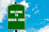 picture of luka  - Green road sign with greeting message WELCOME TO BANJA LUKA isolated over clear blue sky background with available copy space - JPG