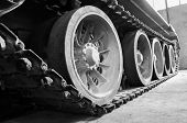 stock photo of tank truck  - truck and wheels of the Soviet tank closeup - JPG