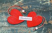 foto of  friends forever  - Friends forever card with two red wooden hearts on rustic wood - JPG