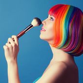 picture of wig  - beautiful woman wearing colorful wig and holding make - JPG