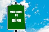 image of bonnes  - Green road sign with greeting message WELCOME TO BONN GERMANY isolated over clear blue sky background with available copy space - JPG