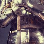 pic of longsword  - knight wearing armor and standing with two - JPG