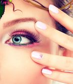 foto of pink eyes  - Blue eye makeup and pink manicured nails  - JPG