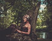 foto of nymphs  - Nymph sitting on her throne in a magical forest  - JPG