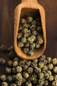 stock photo of peppercorns  - Green Peppercorns on a wooden background, macro ** Note: Soft Focus at 100%, best at smaller sizes - JPG