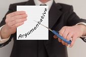 image of argument  - Argumentative man in suit cutting text on paper with scissors - JPG