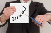 stock photo of dreads  - Dread man in suit cutting text on paper with scissors - JPG